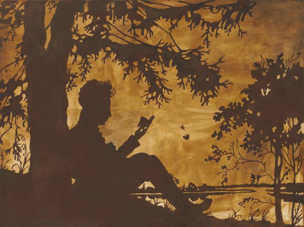 Persoon lezend onder een boom